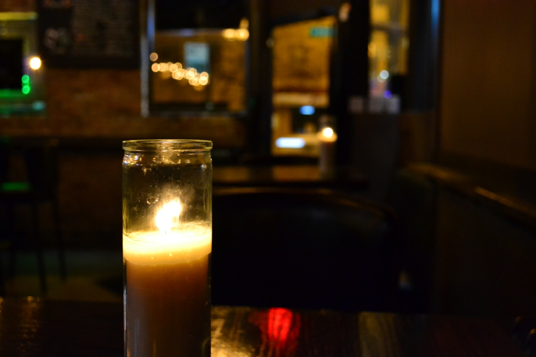 White candle on each table